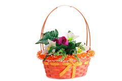 Flowers in basket. Colorful fabric flowers in wicker basket isolated on white background Stock Photos