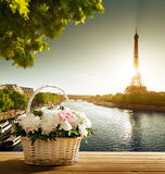 Flowers in basket and Eiffel tower Royalty Free Stock Images