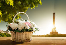 Flowers in basket and Eiffel tower Royalty Free Stock Photos