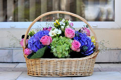 Flowers Basket. With miscellaneous flowers Stock Photos