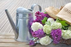 Flowers in basket on terrace Royalty Free Stock Image