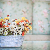 Flowers in basket vase Stock Image