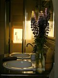 Flowers in the bathroom. Flowers in the luxury bathroom Stock Photography