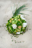 Flowers on beach. A bouquet of flowers on beach Stock Image