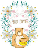 Flowers and a bear with honey Royalty Free Stock Photo