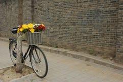 Flowers in a Beijing bike's basket Royalty Free Stock Photo