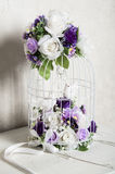 Flowers and bird cages Stock Photo