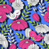 Flowers and birds. Bright summer pattern on a blue background. Birds and flowers. Seamless pattern on a blue background. Prints for wallpaper, wrapper, fabric Royalty Free Stock Image