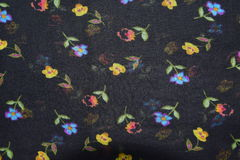 flowers on black fabric pattern background Royalty Free Stock Images