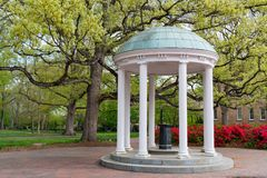 Old Well at University of North Carolina. Flowers Bloom in Spring at the Old Well Rotunda at University of North Carolina in Chapel Hill stock photo