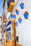 Flowers in blue flowerpot, Cordoba. Spain Stock Photo