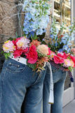 Flowers in Blue Jeans Stock Photo