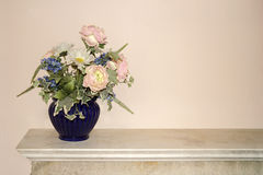 Flowers in a blue vase Stock Photo