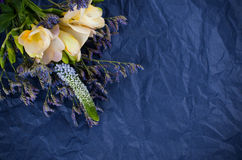 Flowers and blue wrapping paper Royalty Free Stock Images