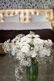 Flowers and blurred bed Royalty Free Stock Photo