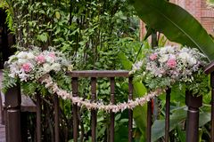 Flowers bouquet arrange for decoration in wedding ceremony. Fresh location Royalty Free Stock Photo