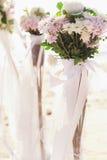 Flowers bouquet arrange for wedding decoration with sea background Stock Photos