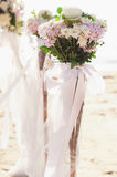Flowers bouquet arrange for wedding decoration with sea background Stock Images
