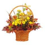 Flowers bouquet arrangement centerpiece in wicker basket isolate Stock Photo