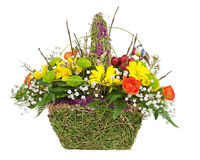 Flowers bouquet arrangement centerpiece in wicker basket. Stock Photo