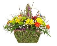 Flowers bouquet arrangement centerpiece in wicker basket. Stock Photo