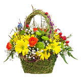 Flowers bouquet arrangement centerpiece in wicker basket. Stock Photography