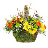 Flowers bouquet arrangement centerpiece in wicker basket. Stock Photos