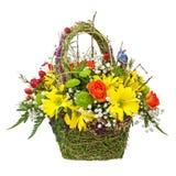 Flowers bouquet arrangement centerpiece in wicker basket. Stock Photography