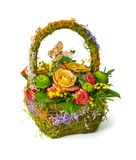Flowers bouquet in basket Stock Photos
