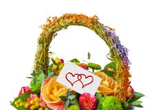Flowers bouquet in basket and greeting card Stock Photography