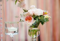 Flowers bouquet and candle as decoration Stock Photography
