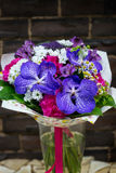 Flowers bouquet with carnation and blue orchids Stock Photos