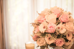 Flowers bouquet on dining table Stock Image