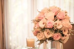 Flowers bouquet on dining table. Light vintage filter effect processing style pictures - Selective focus point Royalty Free Stock Photography
