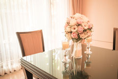 Flowers bouquet on dining table. Light vintage filter effect processing style pictures - Selective focus point Royalty Free Stock Photos