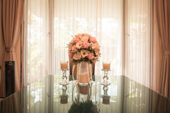 Flowers bouquet on dining table. Light vintage filter effect processing style pictures - Selective focus point Royalty Free Stock Photo