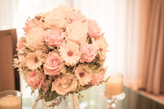 Flowers bouquet on dining table Stock Photo