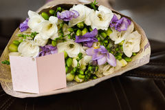 Flowers bouquet of freesia. Flowers bouquet of fresia in interior Royalty Free Stock Image
