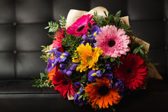 Flowers bouquet of gerbera, iris, and pistacia Stock Photos