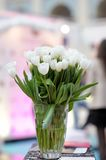 Flowers bouquet in glass vase Stock Photos