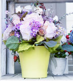 Flowers bouquet in green jug arranged for decoration in home use Royalty Free Stock Images