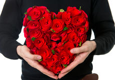 Flowers bouquet in heart shape. Man's hands with red roses. flowers bouquet in heart shape Stock Image
