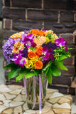 Flowers bouquet with orchids and hidrangea. In glass vase Royalty Free Stock Image