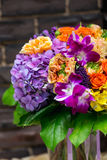 Flowers bouquet with orchids and hidrangea. In glass vase Royalty Free Stock Photography