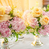 Flowers in a bouquet, pink hydrangeas and yellow rose. Still life with a wedding bouquet of flowers. Pink hydrangeas and yellow rose on table. Close up Stock Photography