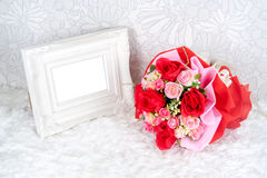 Flowers bouquet placed with picture frame Royalty Free Stock Photos