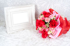 Flowers bouquet placed with picture frame Royalty Free Stock Image
