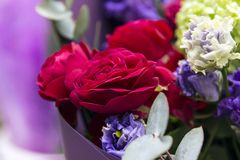 Bouquet of red roses and lilac eustomas, flowers. Flowers, bouquet of red roses and lilac eustomas, flowers, bouquet of red roses and lilac eustomas stock images