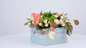 Flowers, bouquet, rotation on white background, floral composition consists of eucalyptus, cineraria, Rose cream grace. Rose barbados, Eustoma, solidago stock video