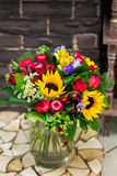 Flowers bouquet with sunflowers. In glass vase Royalty Free Stock Photos